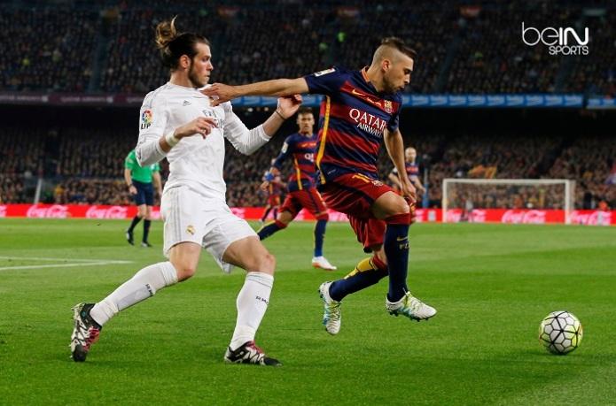 Football Soccer - FC Barcelona v Real Madrid - La Liga - Camp Nou, Barcelona - 2/4/16 Barcelona's Jordi Alba in action with Real Madrid's Gareth Bale Reuters / Albert Gea Livepic EDITORIAL USE ONLY.
